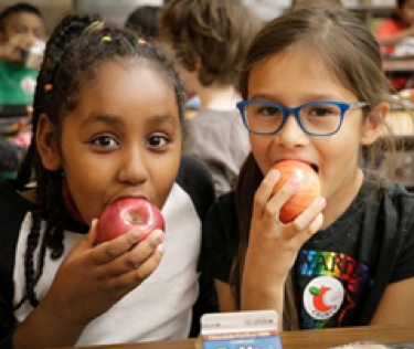 Students at Richfield Public Schools crunch into Minnesota Grown apples