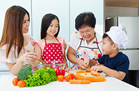 Asian American family cooking together