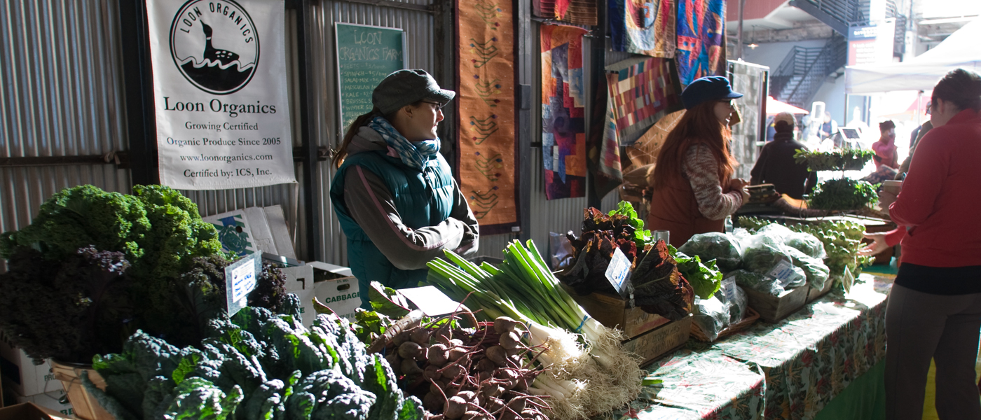 Woman selling vegetables at a farmer's market