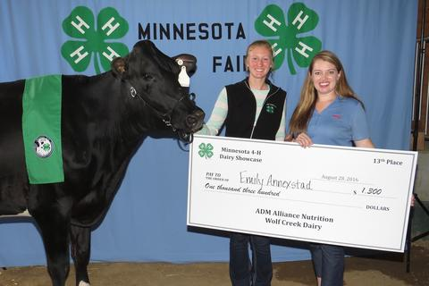 Emily Annexstad and 4-H presenter with her cow and a big check at Minnesota State Fair