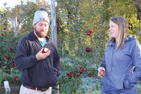 Annie Klodd in orchard talking with cider maker