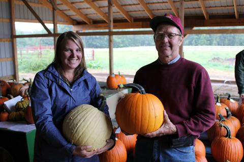 Annie Klodd with Rod Elmstrand holding pumpkins