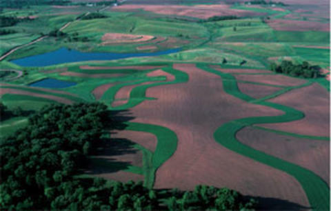 aerial photograph of farmfields and a lake