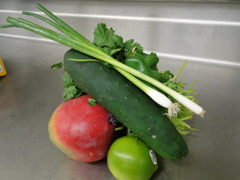 Small pile of vegetables on a stainless steel surface.