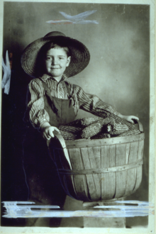 Young Boy Holding Basket
