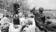 Man giving presentation to a group of children