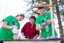4-H youth conducting a science experiment under supervision
