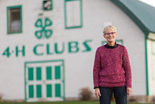 Sue Craig in front of a 4-H building