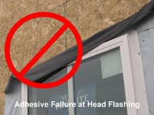 Adhesive failure at head flashing.