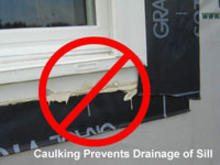 Caulking prevents drainage of sill.