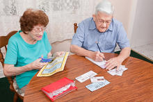 Older couple clipping coupons