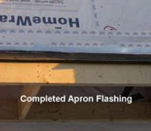 Completed apron flashing on house roof.