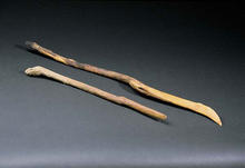 two wooden sticks with slanted ends.
