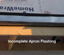 Incomplete apron flashing on house roof.
