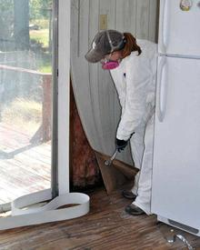 Removing paneling after flood.