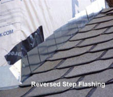 Reversed step flashing on house roof.