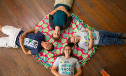 4 youth lounging around on the floor