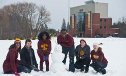 6 people posing in snow at UMD