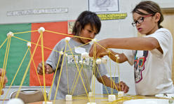 kids building with marshmallows and noodles