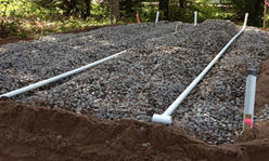 Septic system drainfield installation.