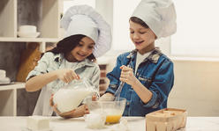 two kids cooking