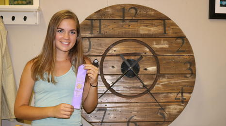 Paige Hanson of Kandiyohi county with her purple ribbon for home environment project.