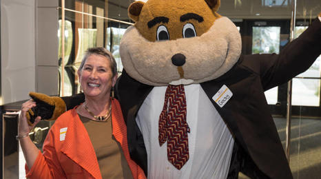 Barb Lukkonin and Goldy Gopher.