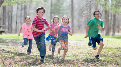 children running in the woods