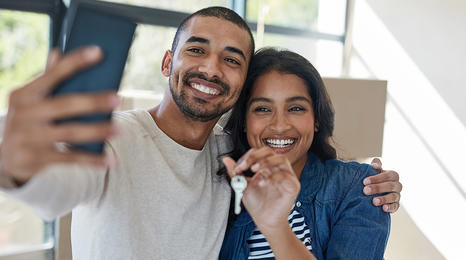 man and woman taking a cell phone selfie