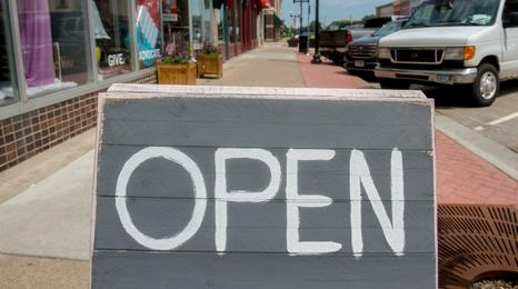A downtown business open sign