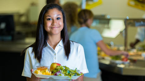 Student with school food tray