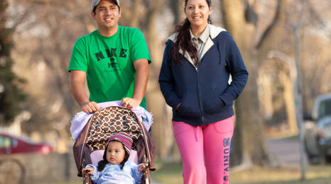 A Hispanic family with a child in a stroller