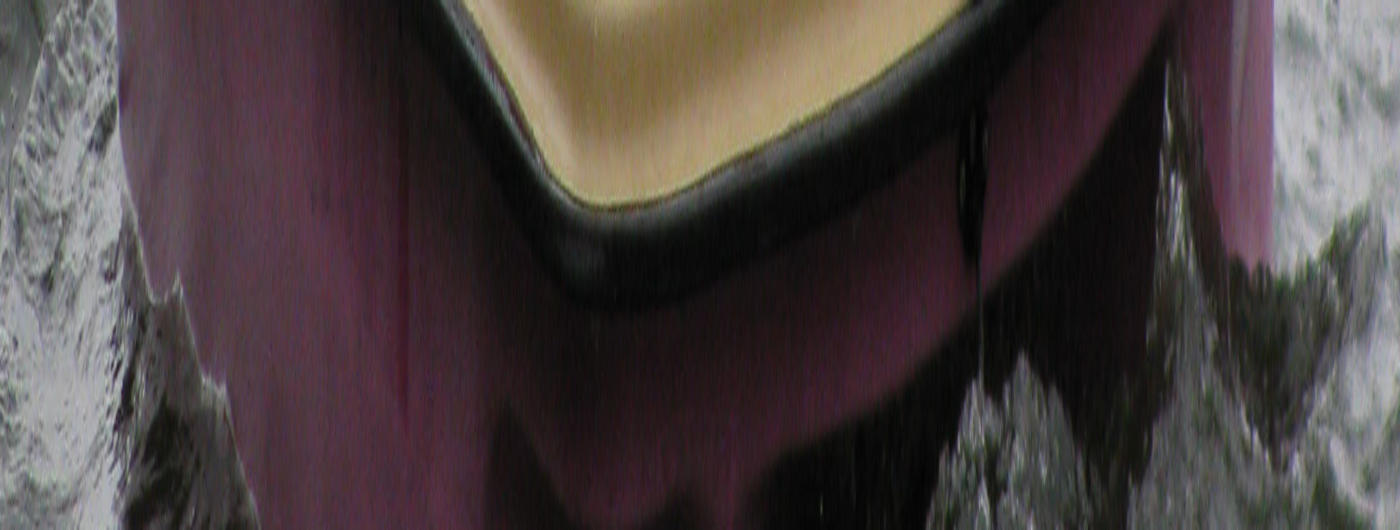 3 boys in paddle boat at camp