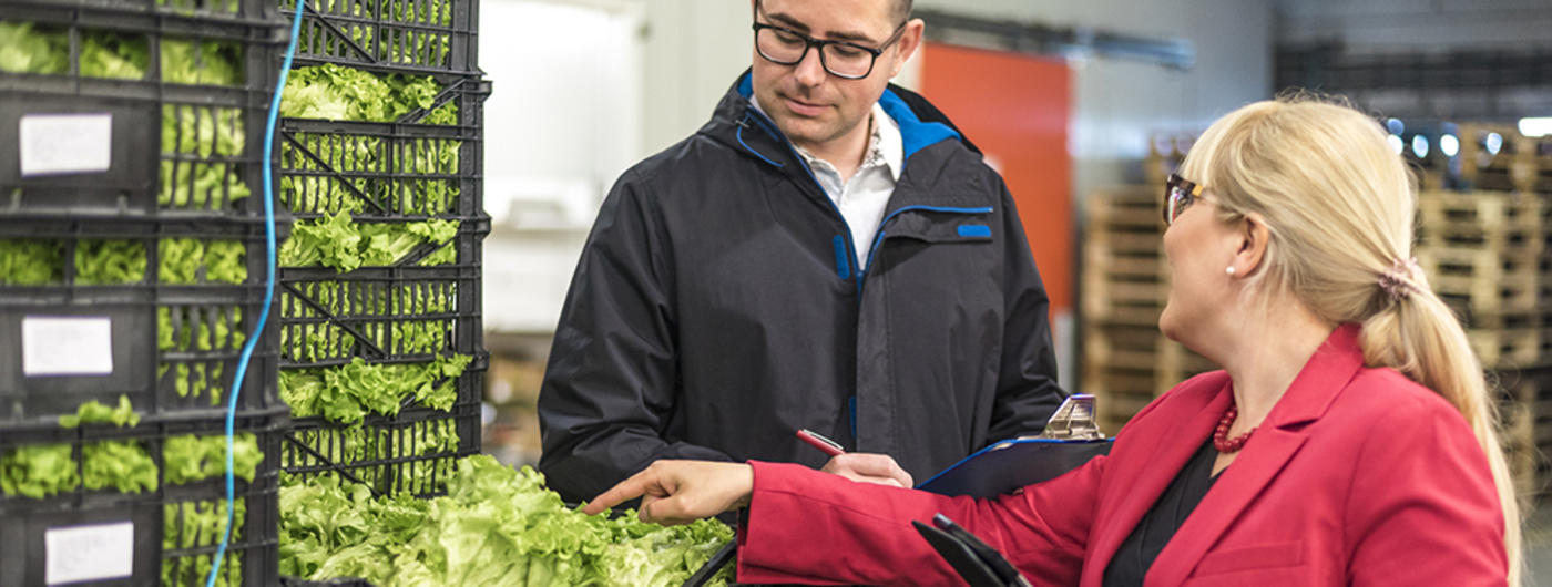 Woman talking to produce delivery man
