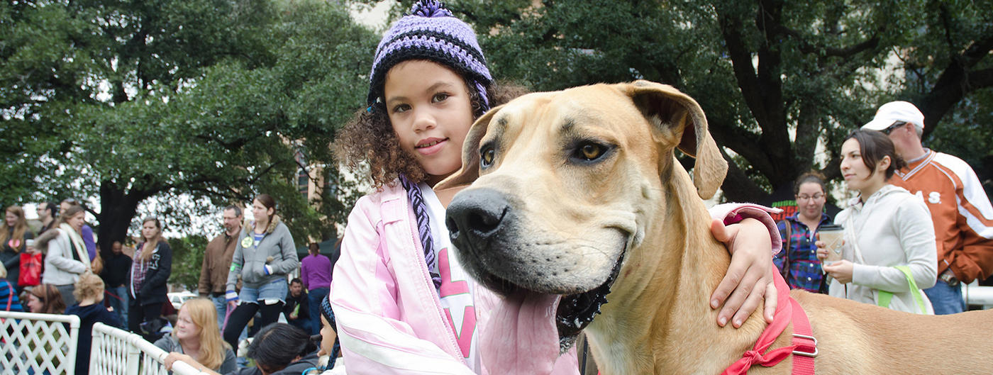 girl next to dog
