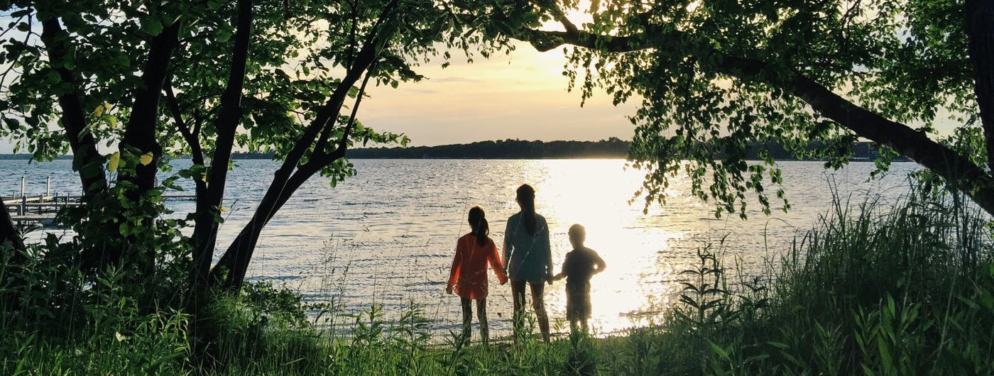A family enjoying the view of a Minnesota lake