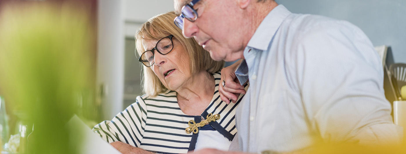 Older couple reviewing paperwork
