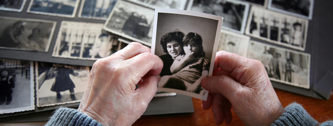 Man looking at old photographs