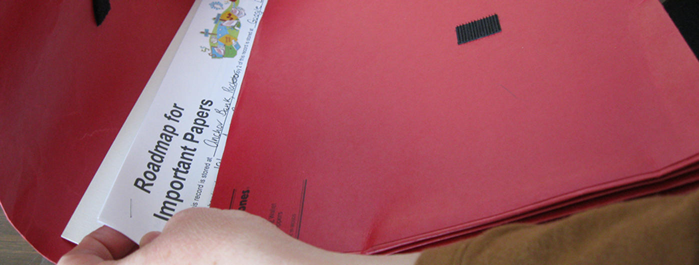 "red file folder with the words ""replacing important papers"""