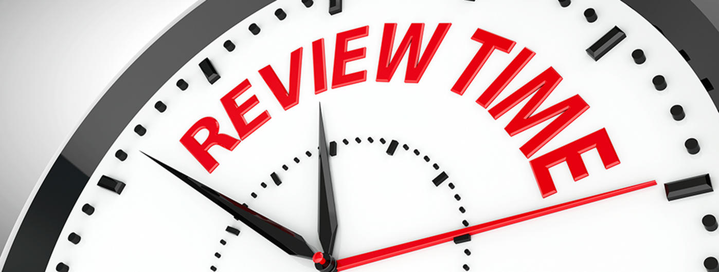 Clock face with the words review time