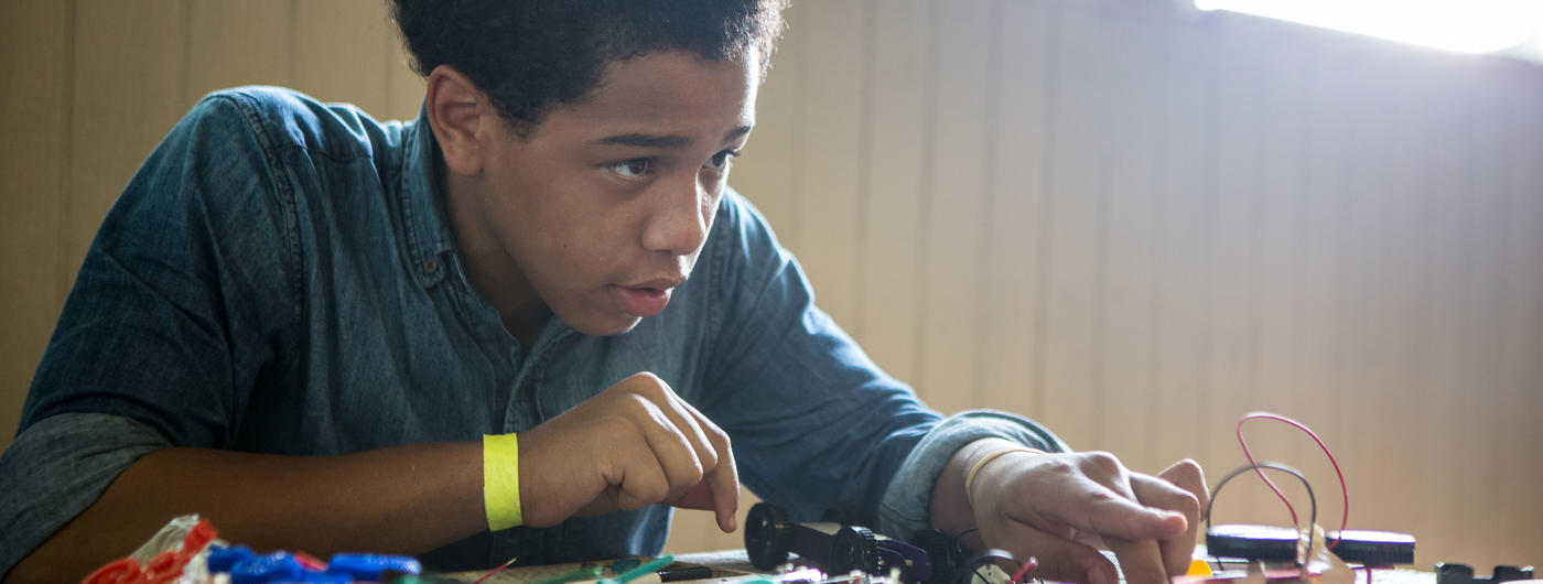 young man experimenting with electronics