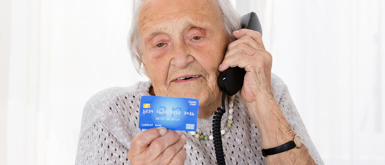 Elderly woman on phone with credit cad