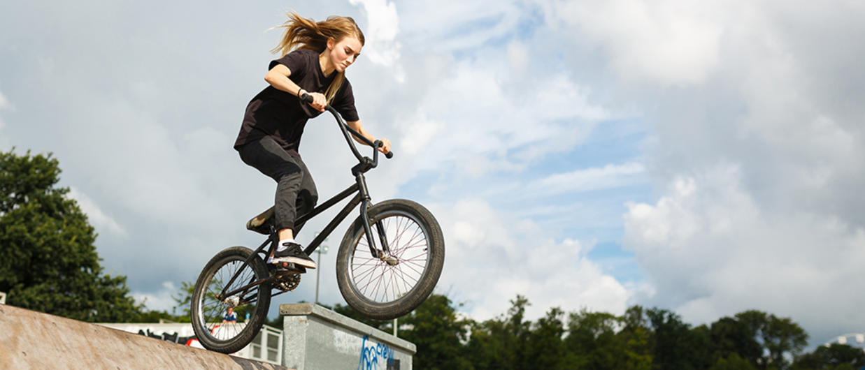 Teen doing stunt biking