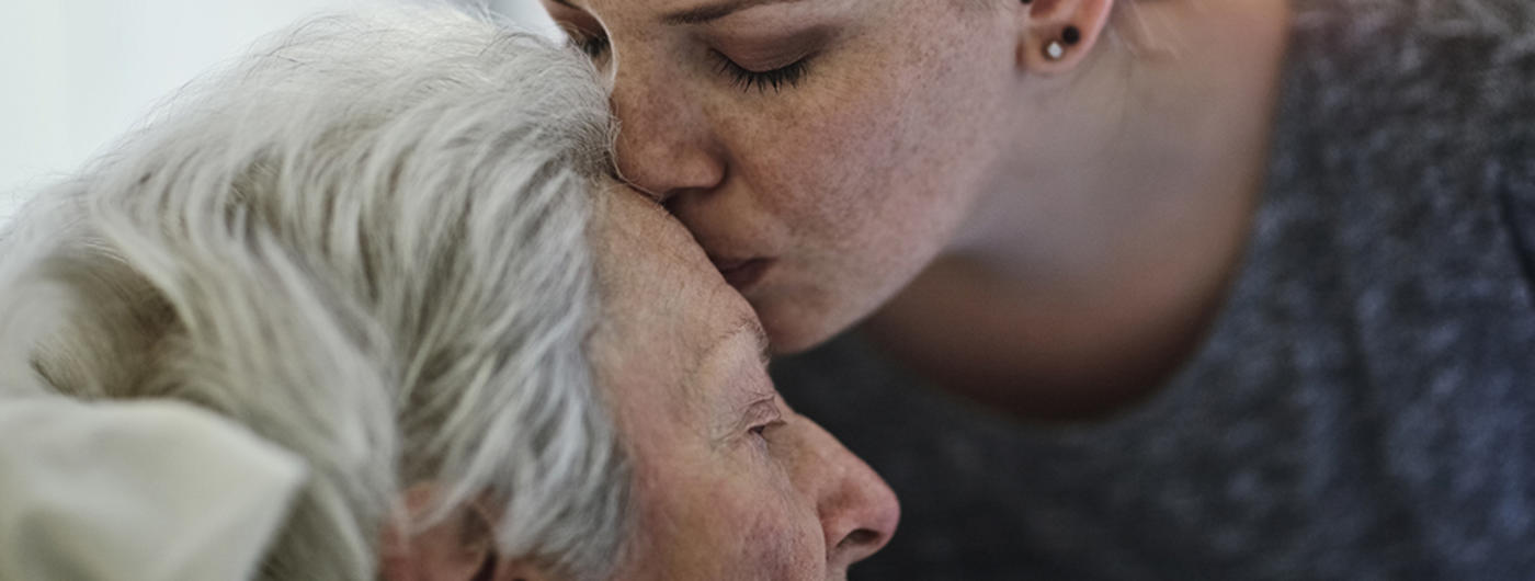 Woman kissing grandmother