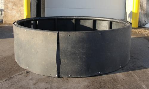 Solid poly ring feeder for round bales.