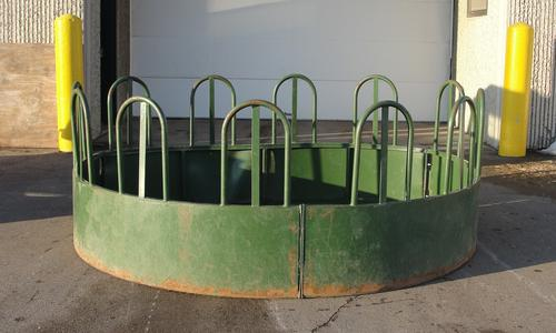 Tombstone style round bale feeders.