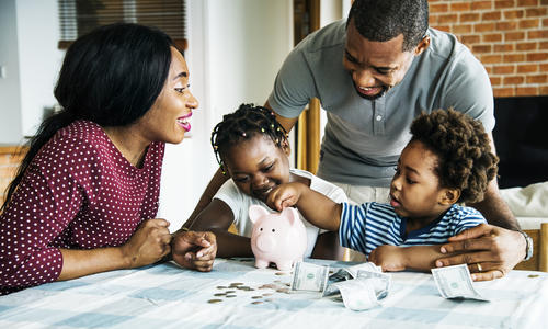 family saving money, two parents and two children