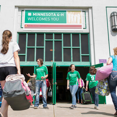 People walking into the 4-H building on the State Fair grounds