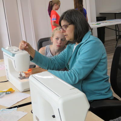 adult and kid sewing