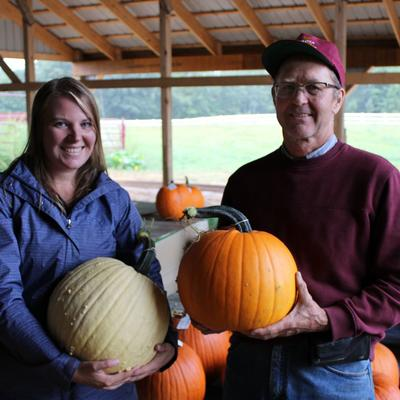 Annie Klodd and Rod Elmstrand holding pumpkins
